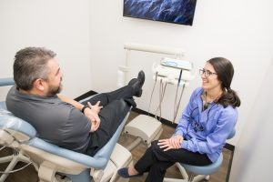 Dr. Bassett and patient at Paloma Dental in Denver, Co